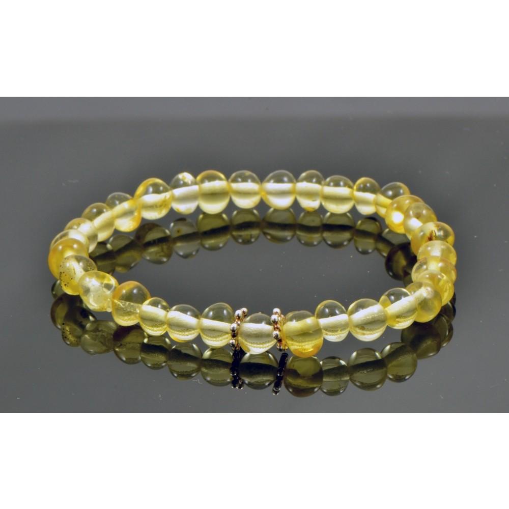 rav armbånd m. elastik - større børn - lys rav med sølvblomst